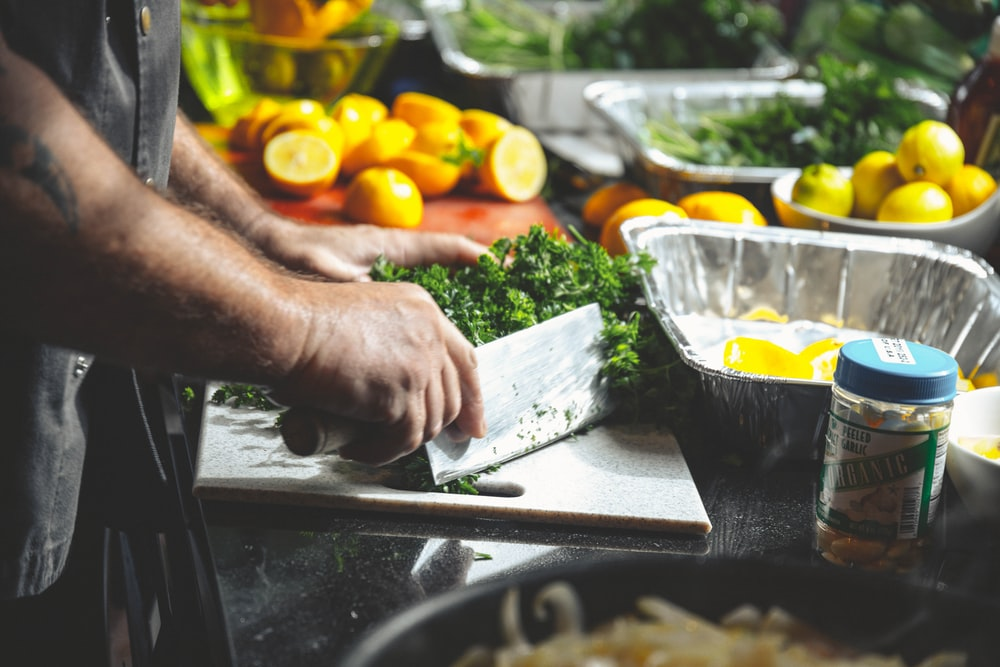 person slicing herbs
