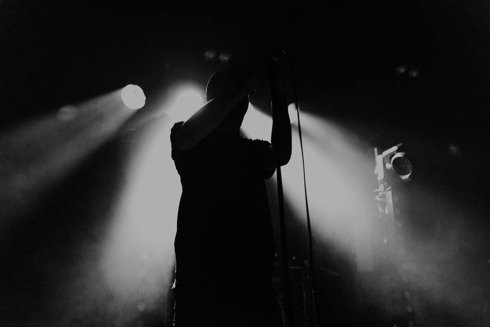 standing man on stage