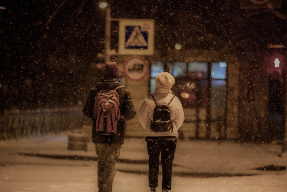 couple walking outside with snow