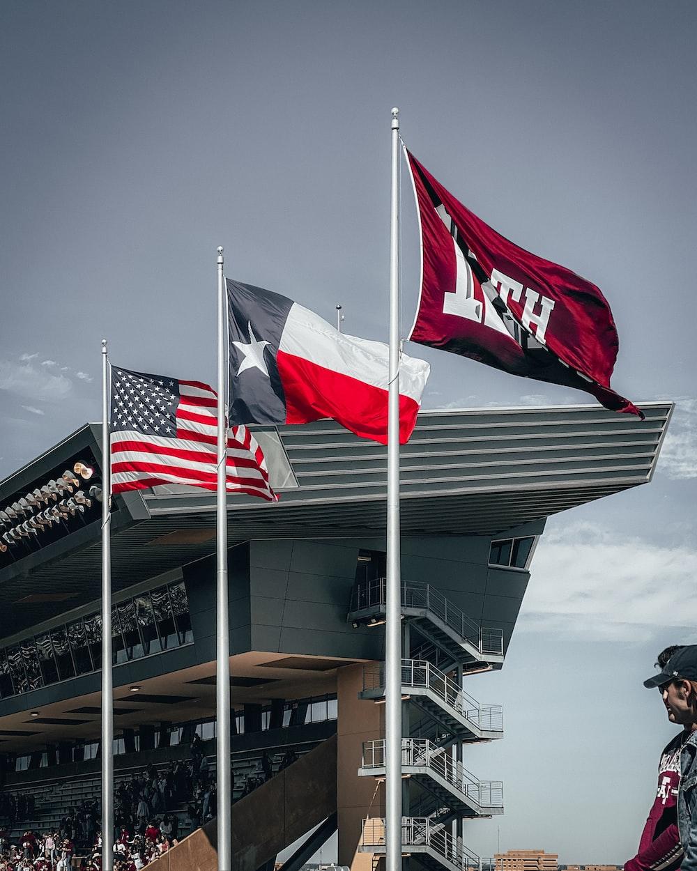 three flags on pole