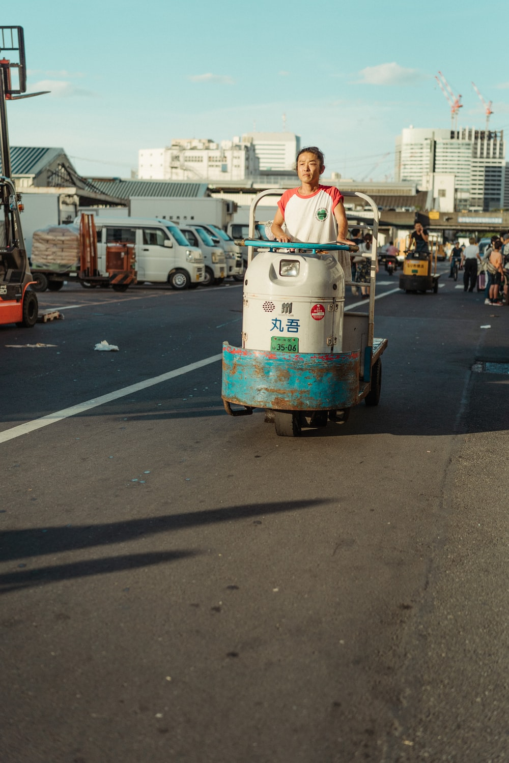 woman on cart on road