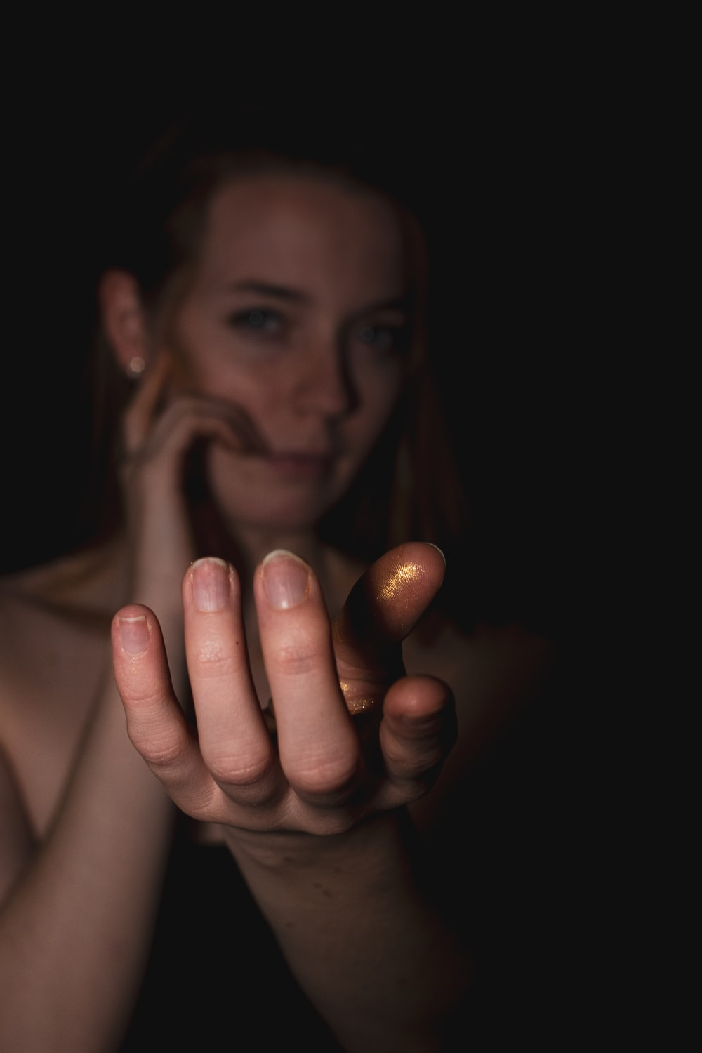shallow focus photo of woman showing left hand