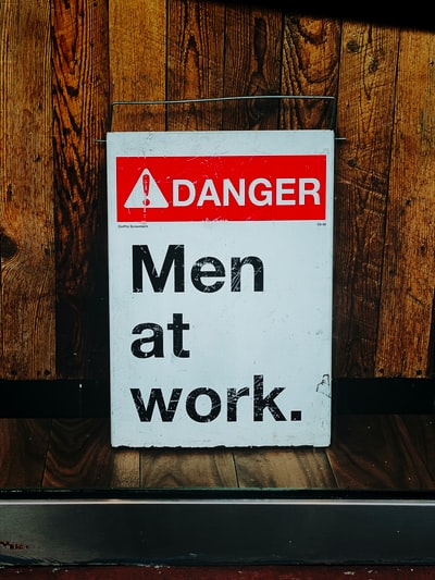 Danger men at work signboard
