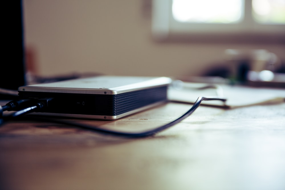 gray and black corded device on table