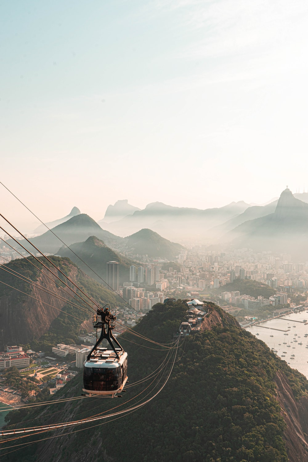 white cable cars on mountain