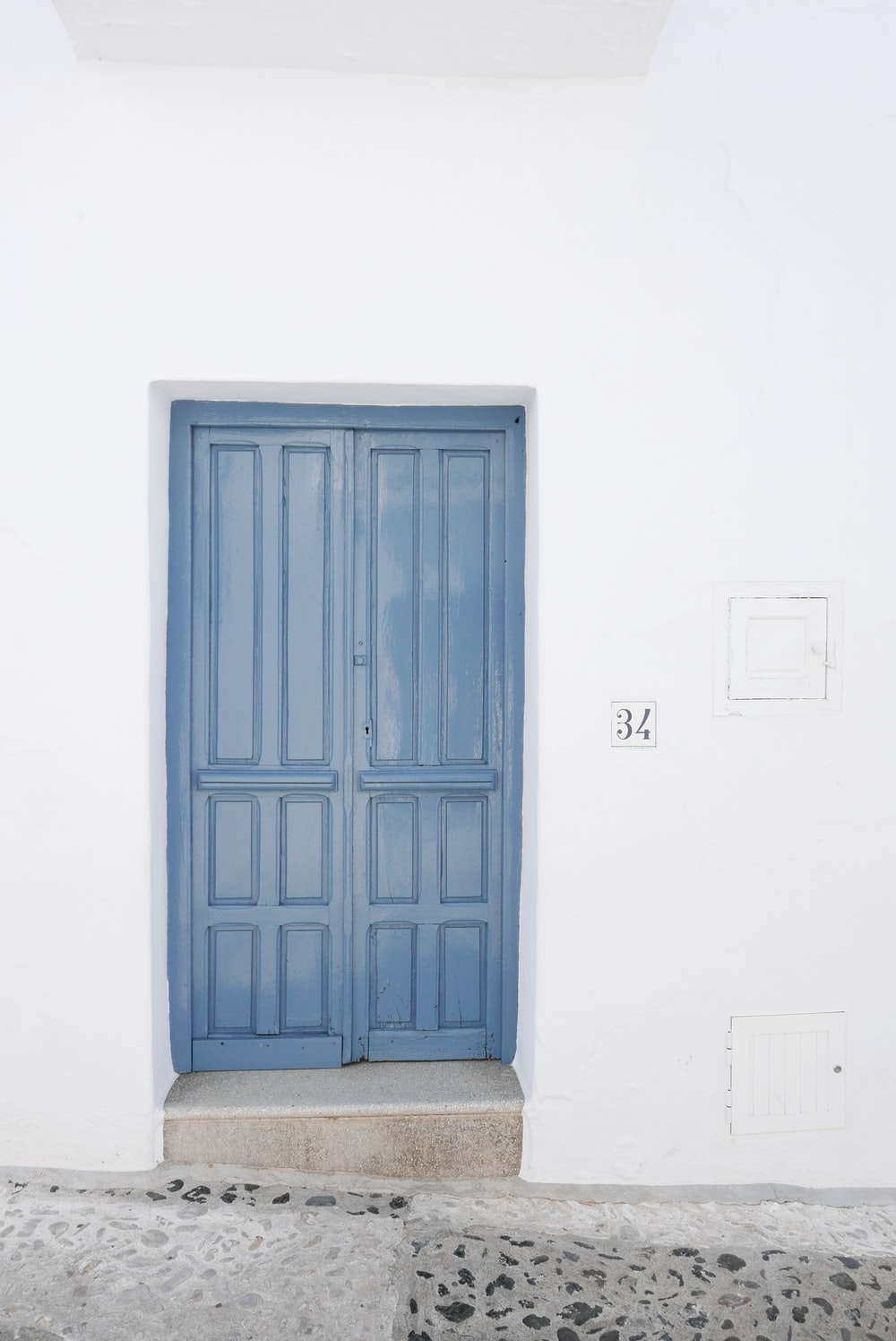 blue wooden 2-way door panel inside white room