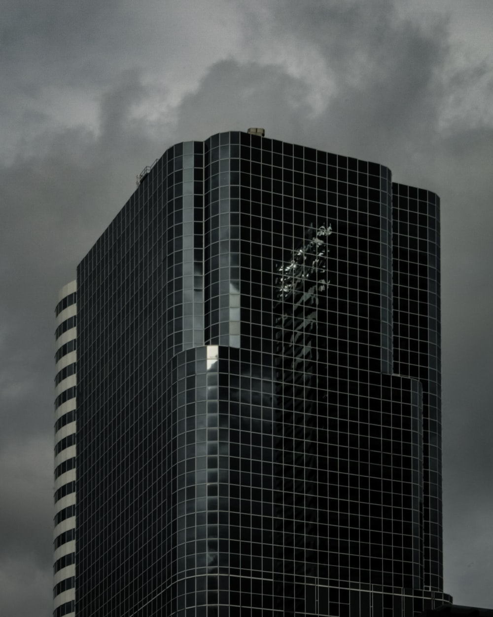 greyscale photography of curtain building