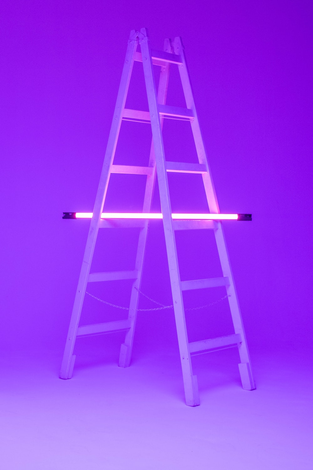 turned-on fluorescent lamp on folding ladder