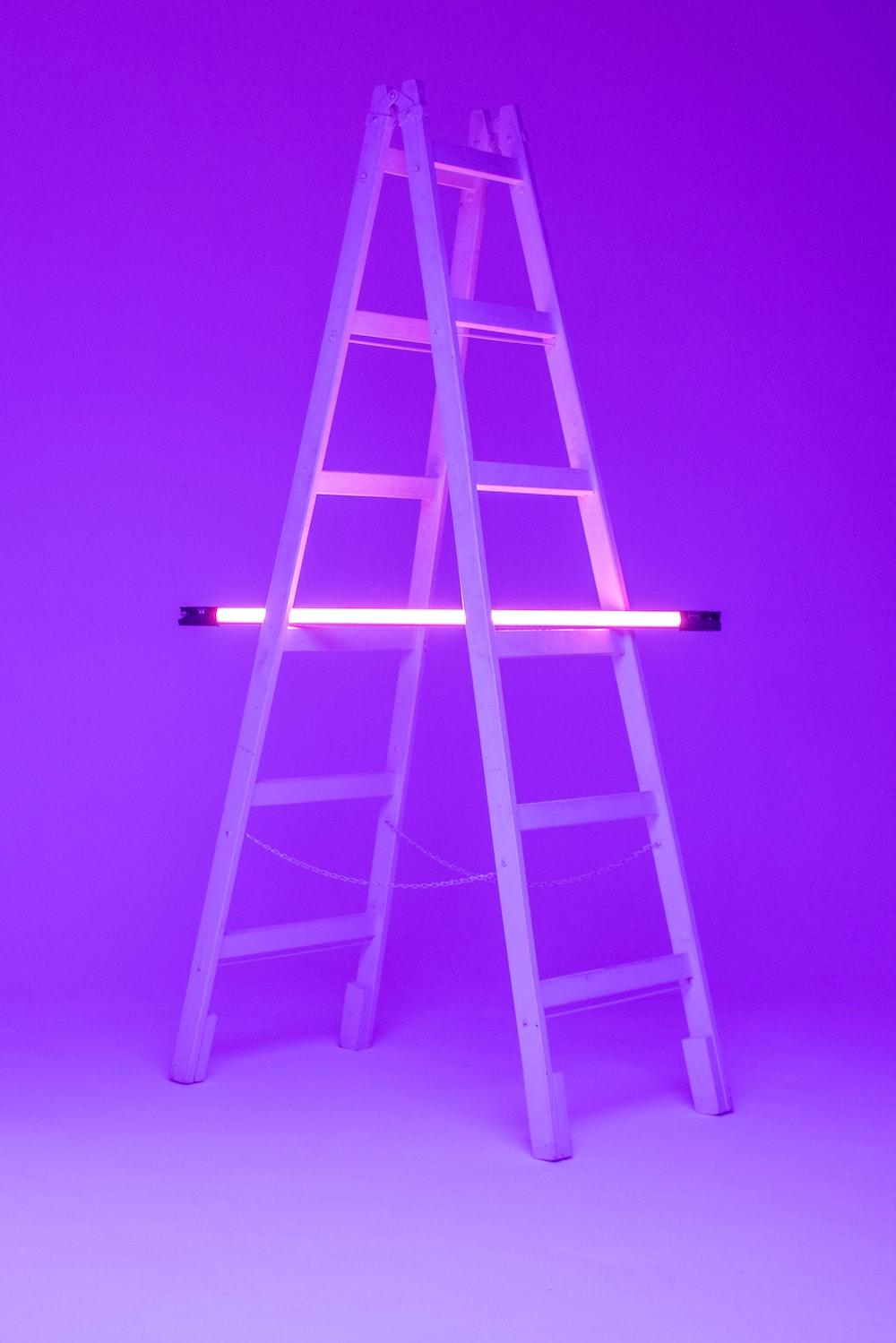 turned-on fluorescent lamp on folding ladder