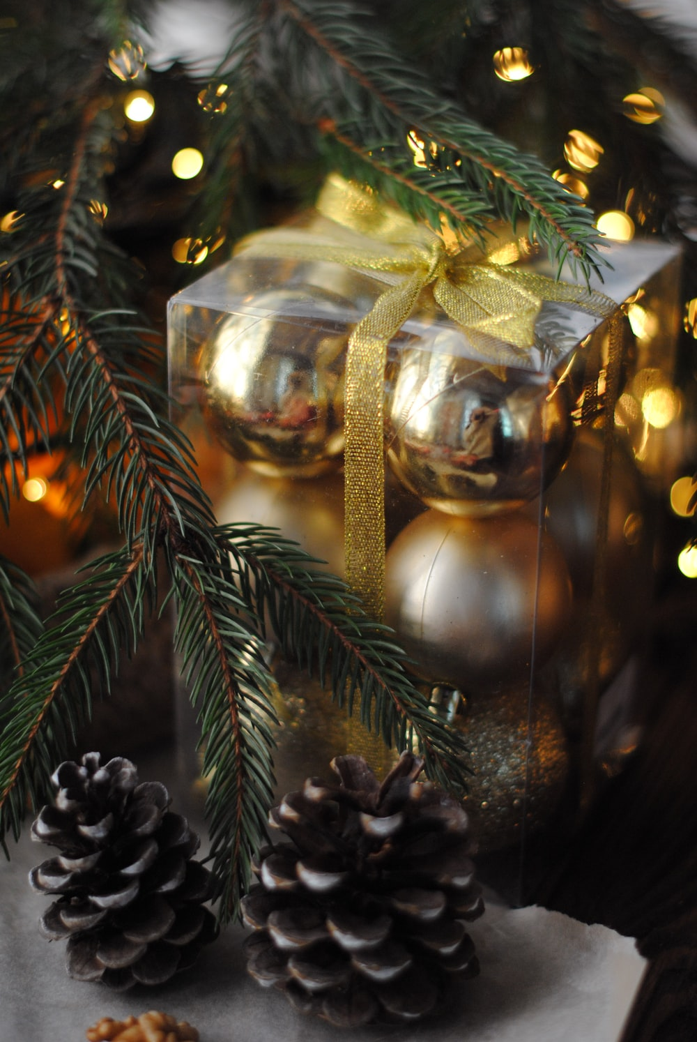 gray baubles beside Christmas tree