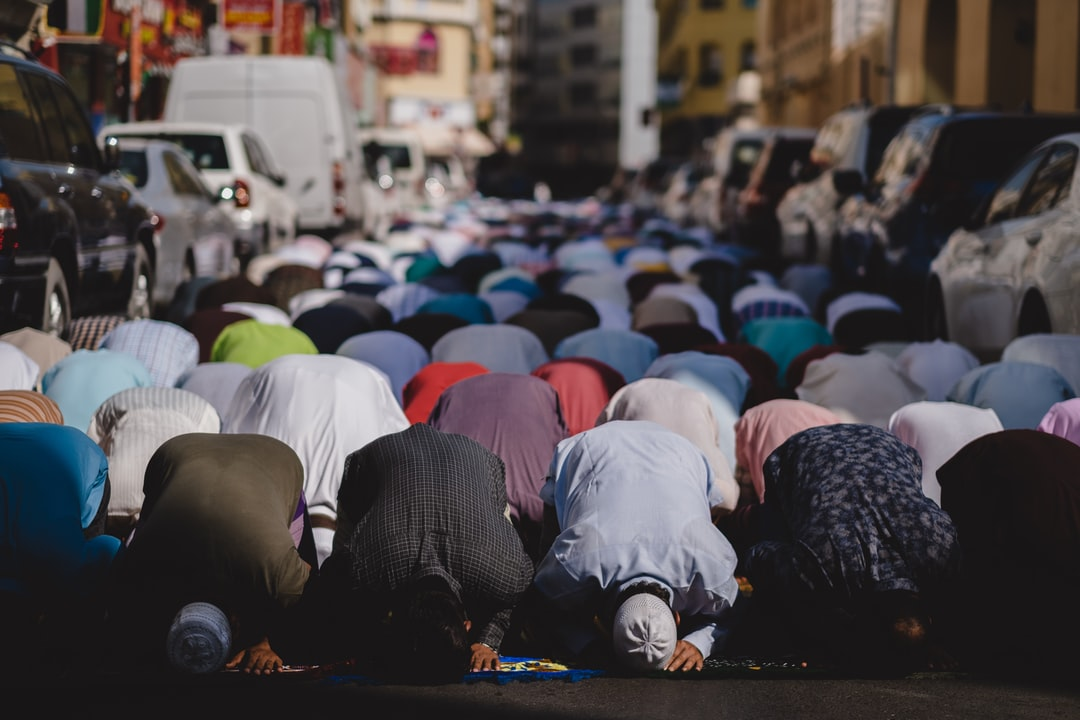 Muslims praying on Friday in Dubai. The congregation has spilled onto the road outside of the mosque.