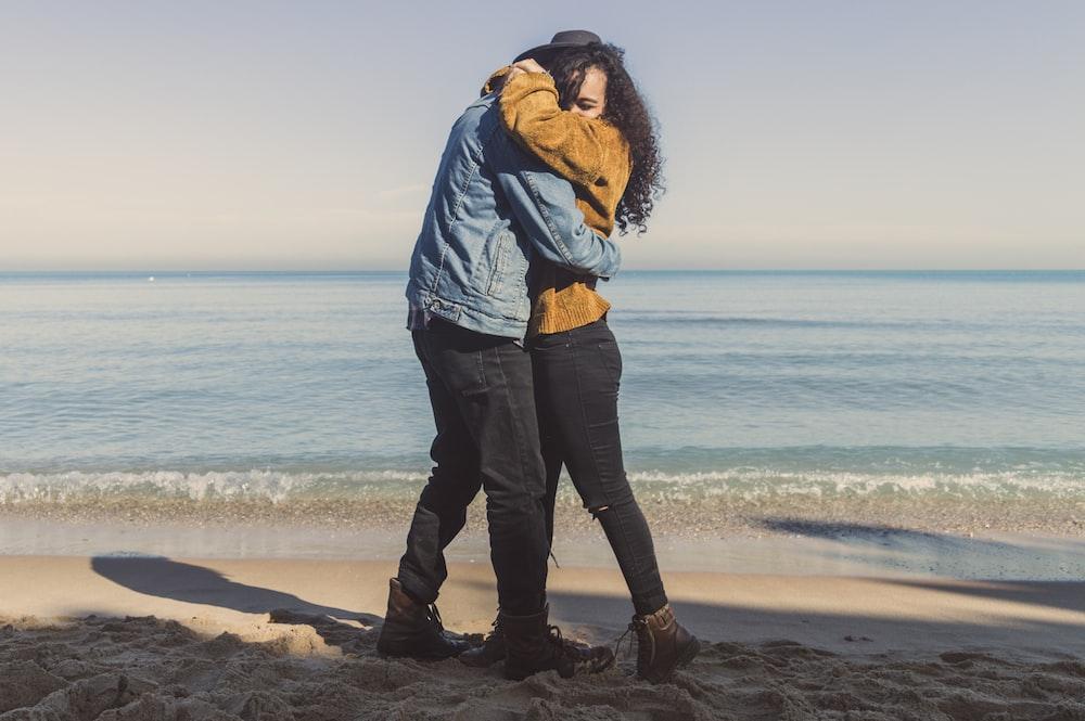hugging man and woman on seashore