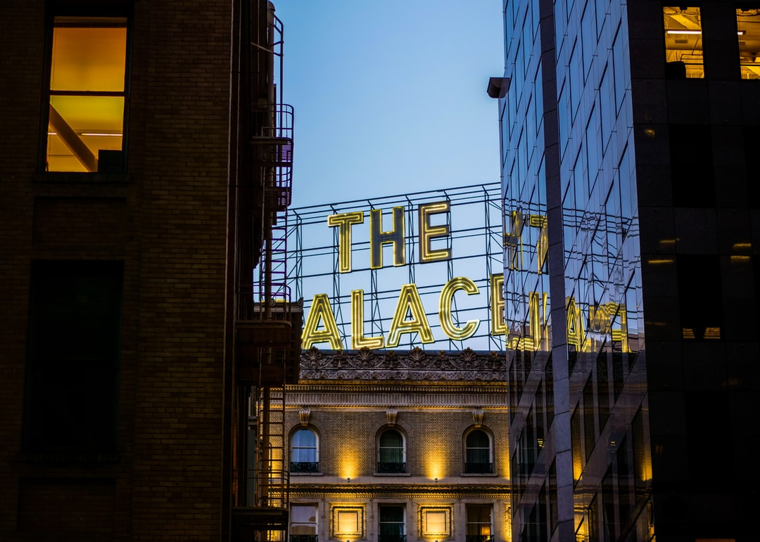 The Palace Hotel neon sign through the buildings of San Francisco.