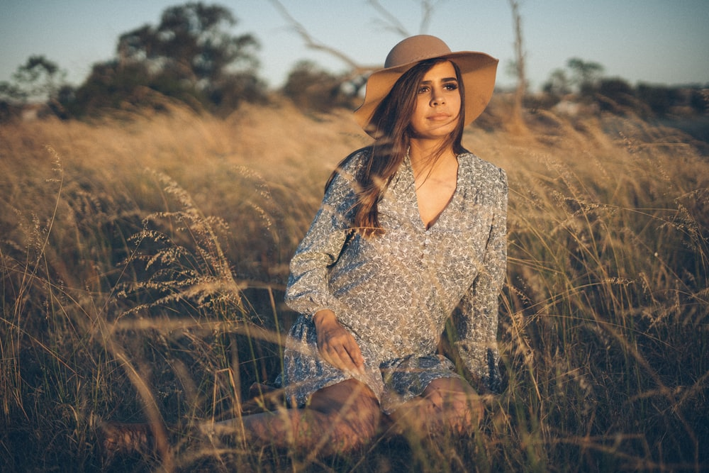 woman sitting on plant field
