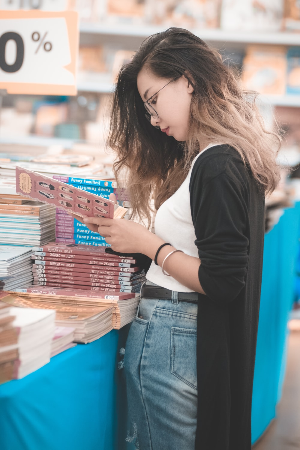 woman standing infront of books