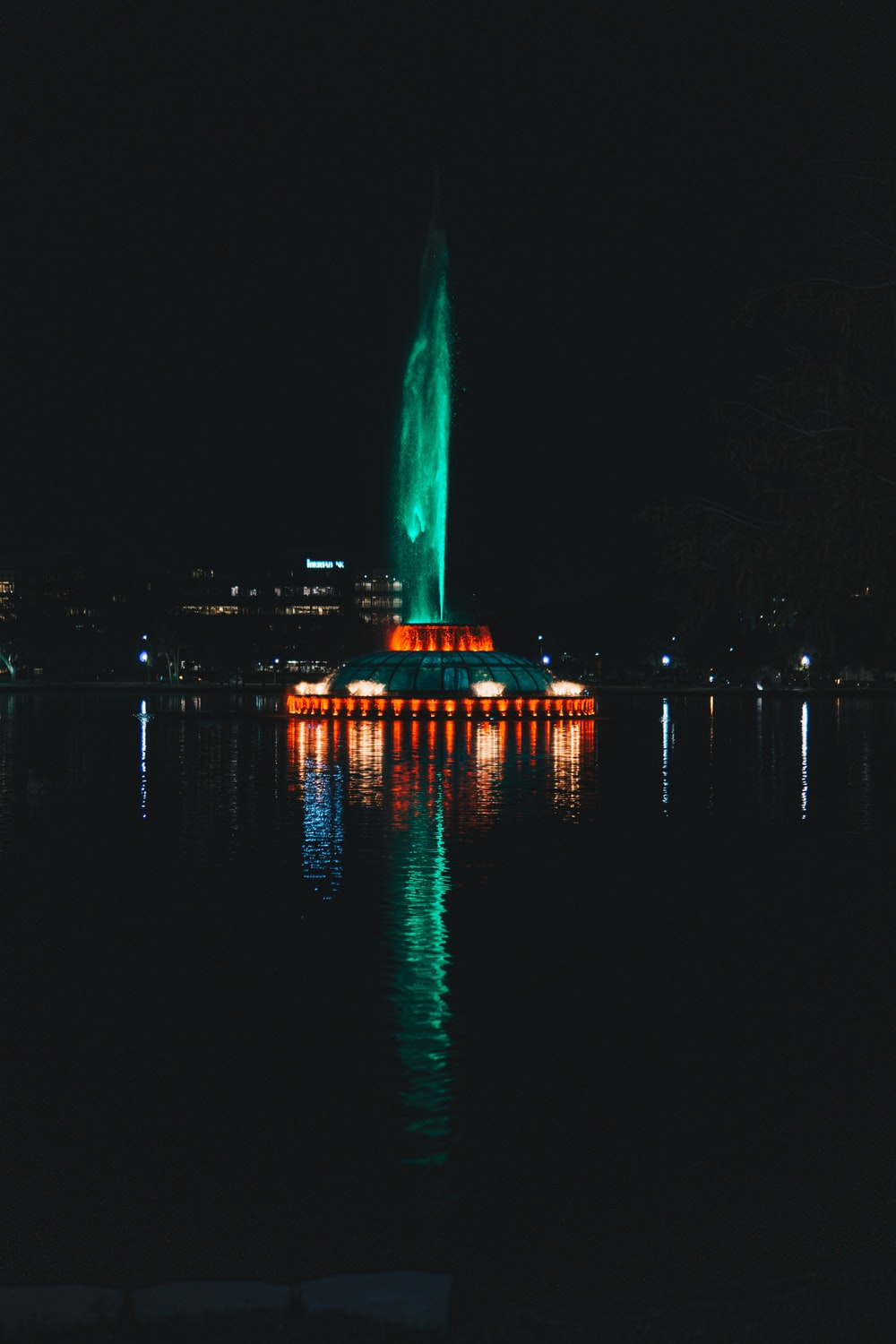 lighted fountain during nighttime