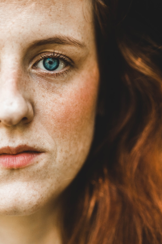 left cheek of green-eyed woman