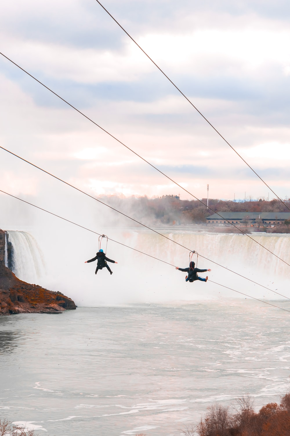 two person riding on the rides over body of water
