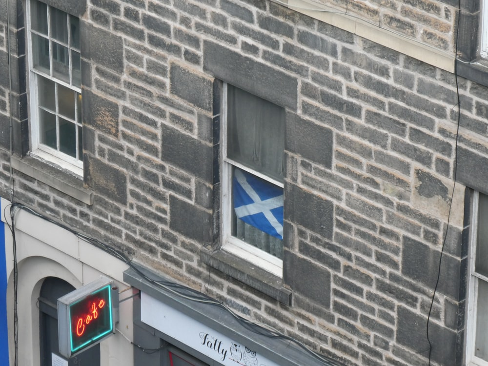 white and blue flag in the window