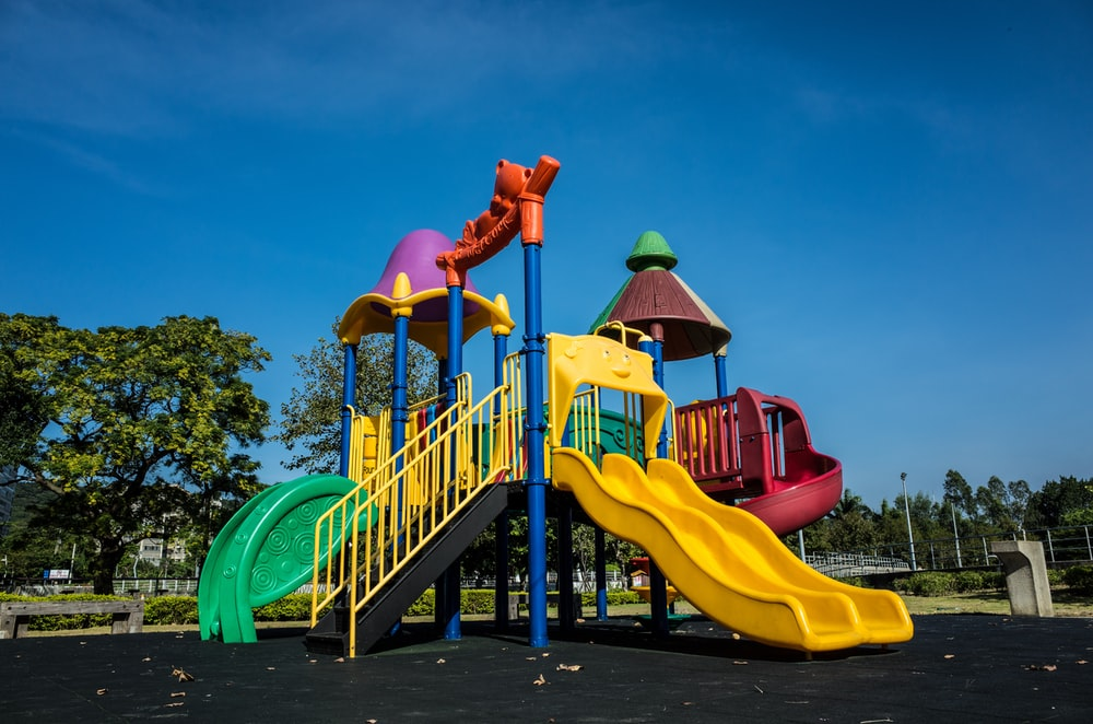 multicolored playground slide during daytime