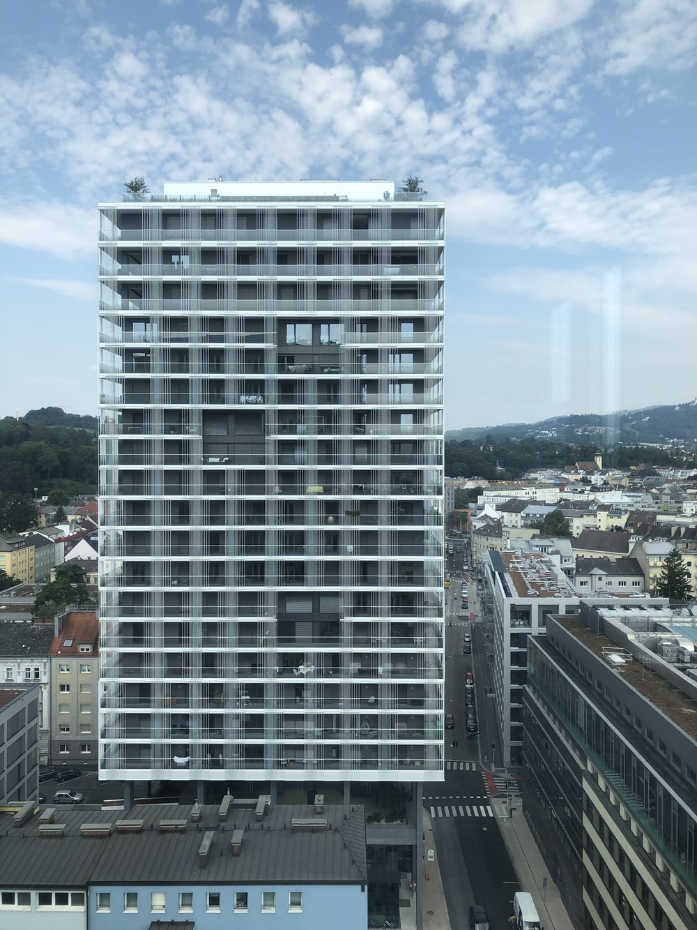 high-rise building near city under boue sky