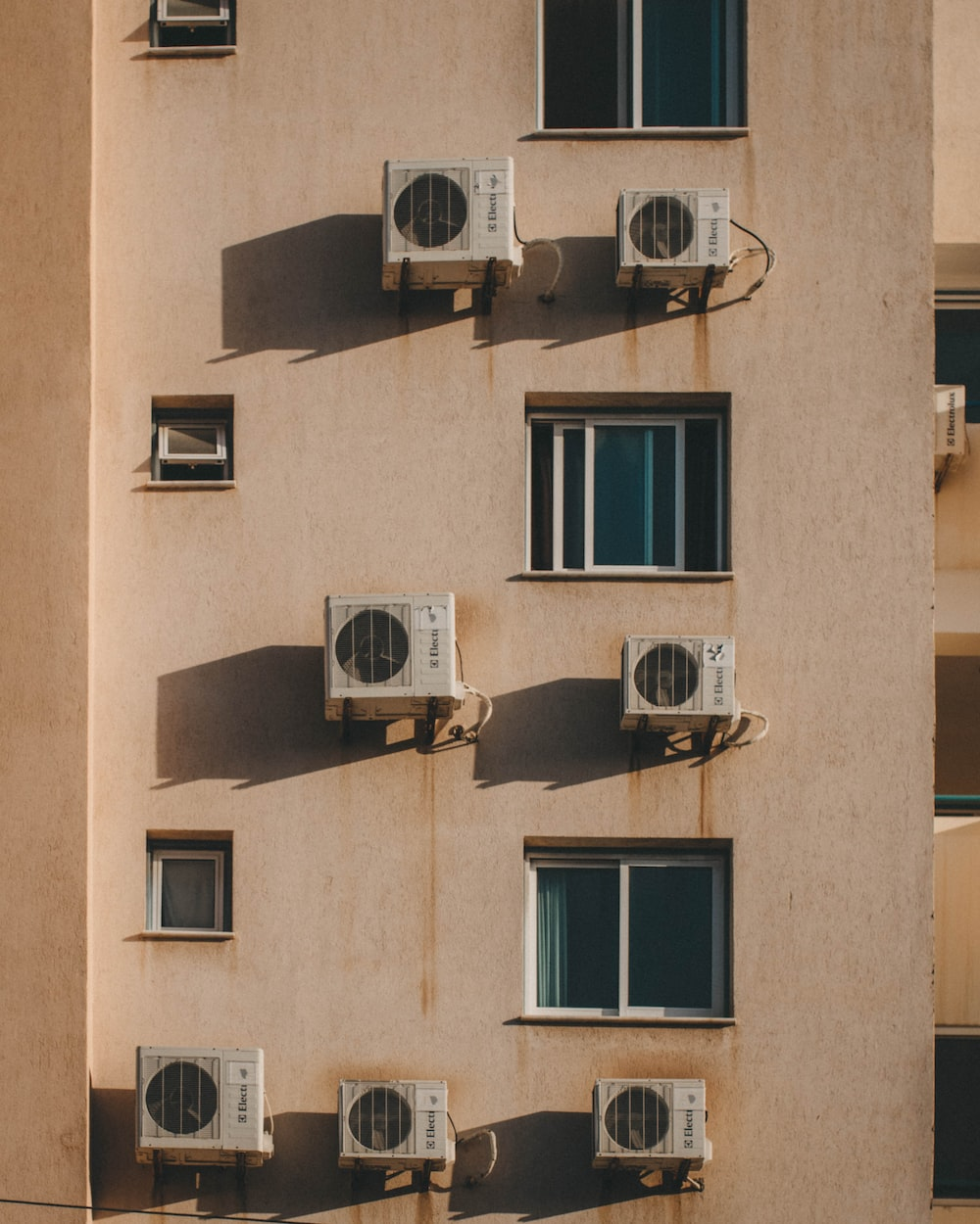 AC units mounted on wall outside building