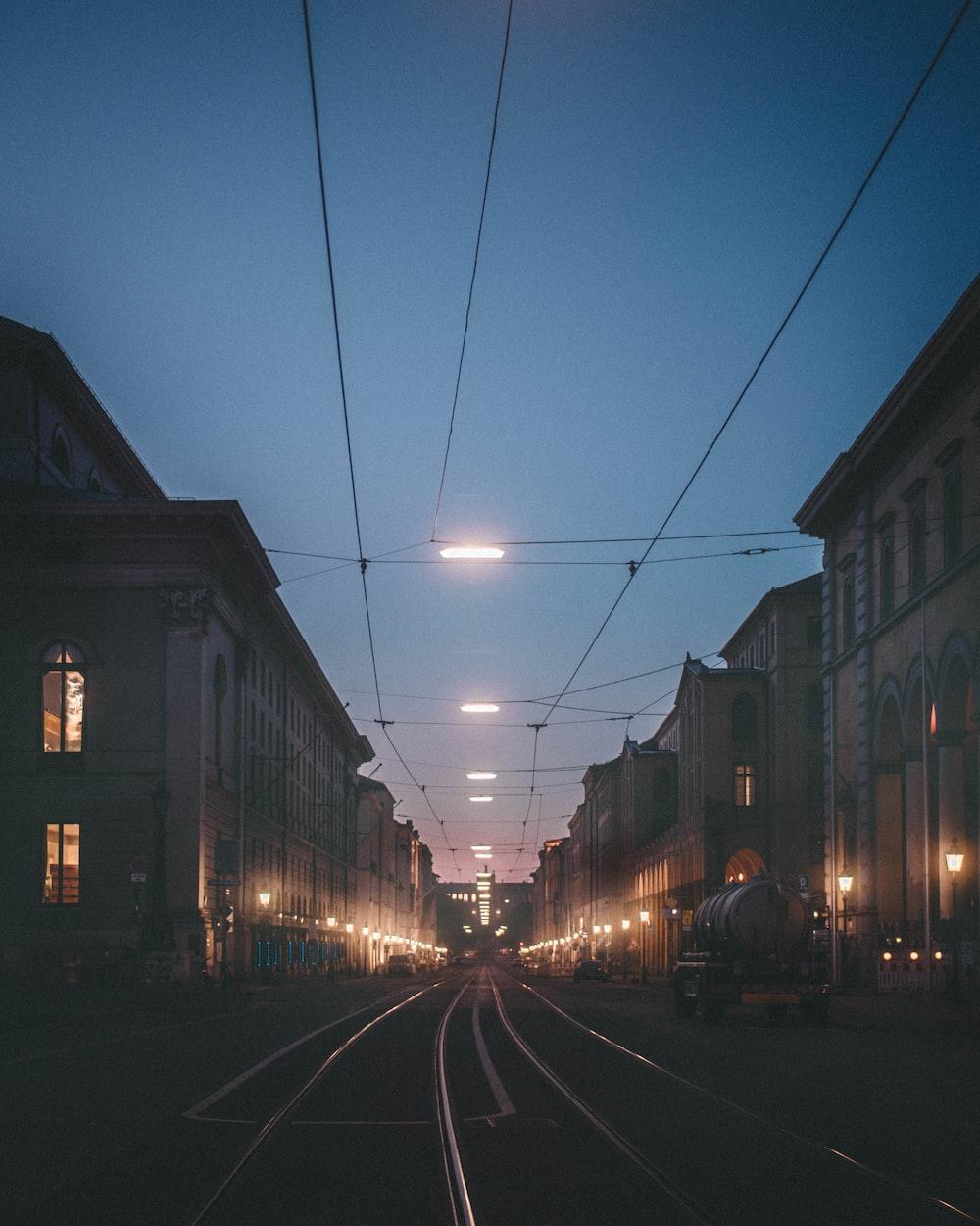 lighted tram rail between buildings