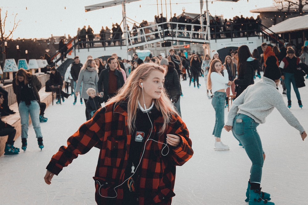 people skating on ice during day