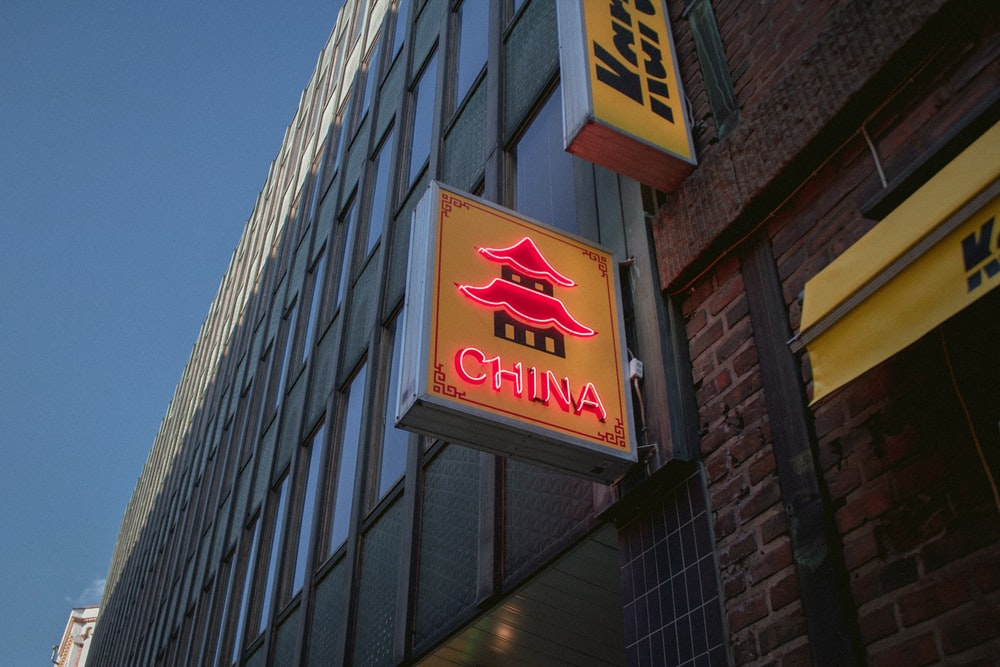 red and yellow China signage near building
