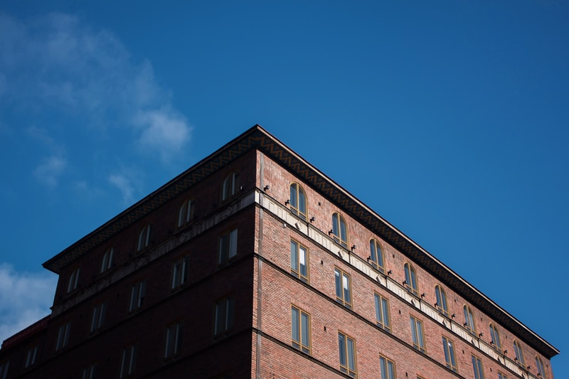 low-angle photo of brown building under blue sky