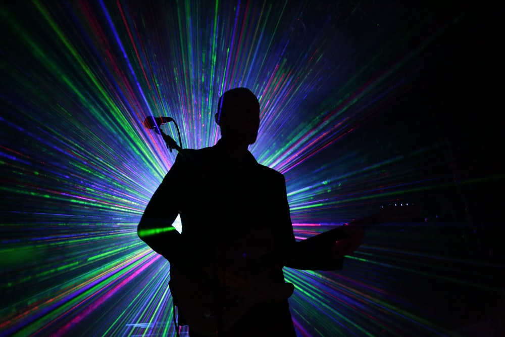 silhouette of person playing guitar