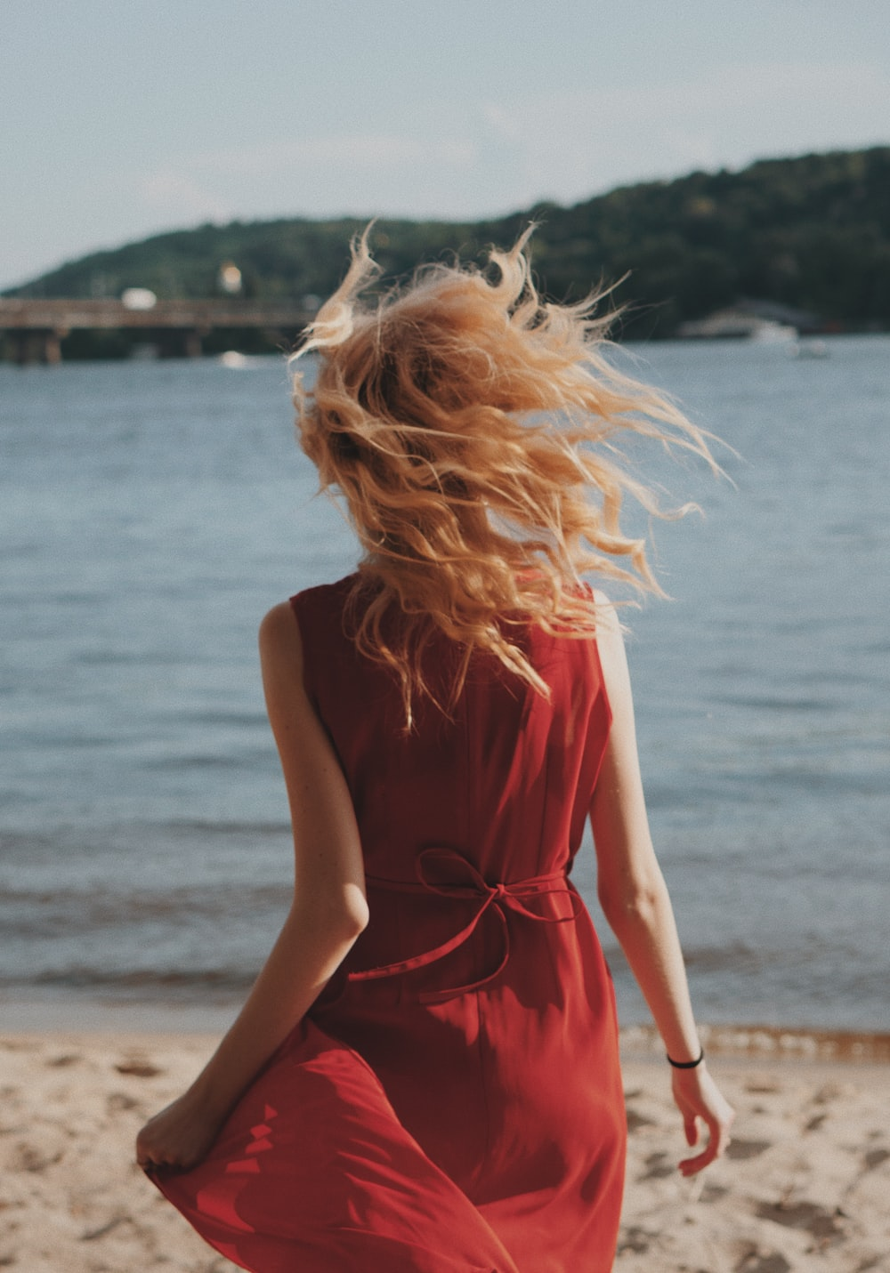 women's red sleeveless mini dress at shore