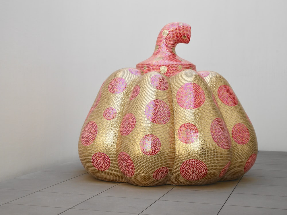 gold-colored and red pumpkin container with lid