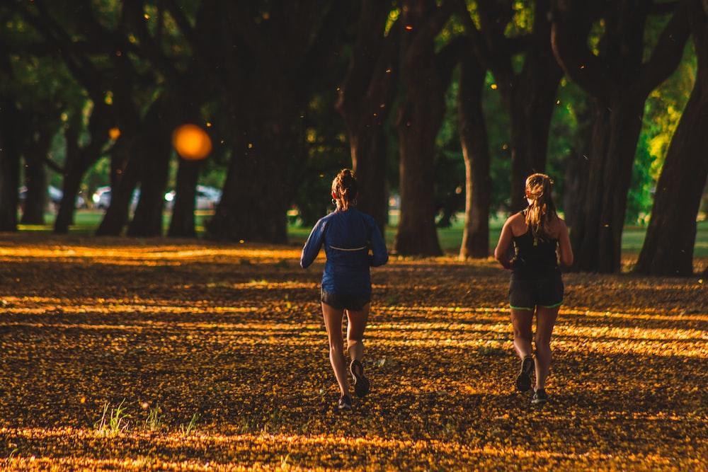 two women running on park