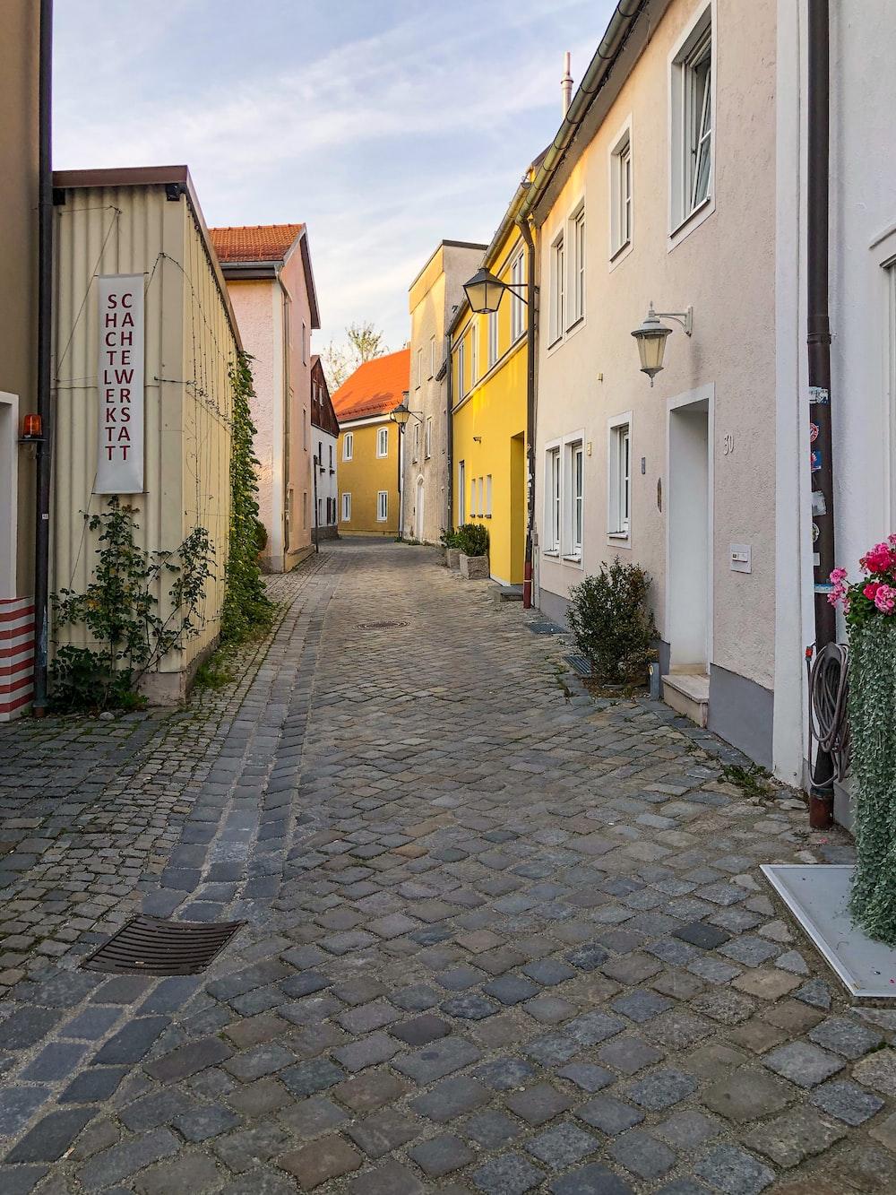 brick walkway between houses
