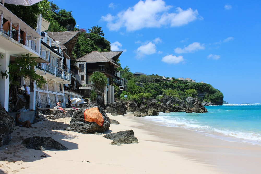 houses beside shore during daytime
