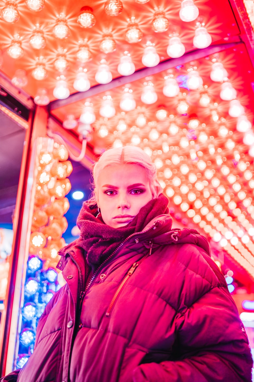 woman wearing coat under lights