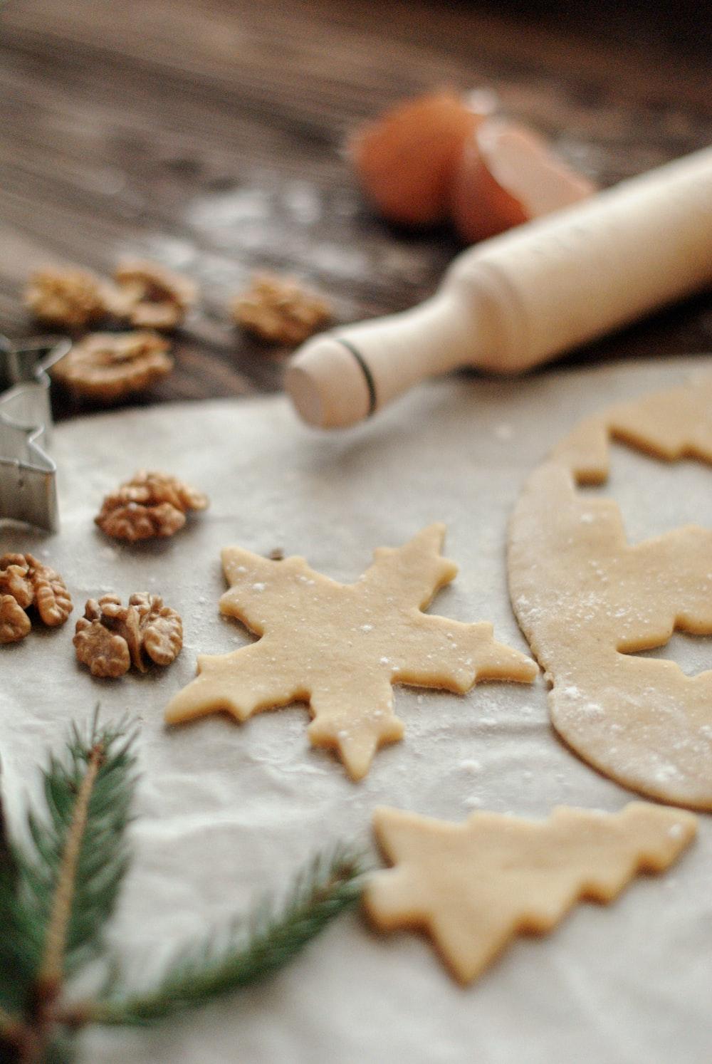 rolling pin beside cut cookie dough