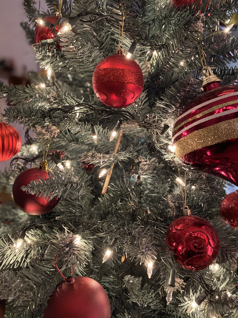gray Christmas tree and red baubles