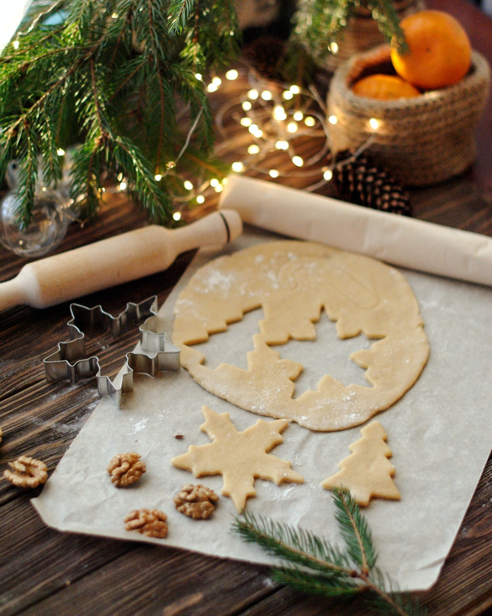 cookie cutter and rolling pin beside string lights