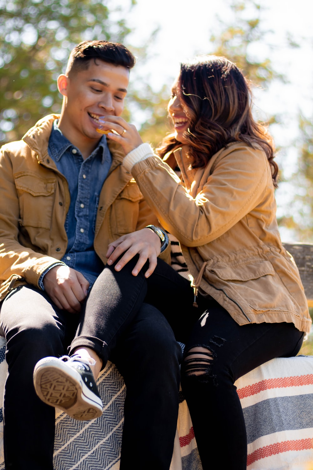 couple wearing brown button-up jacket