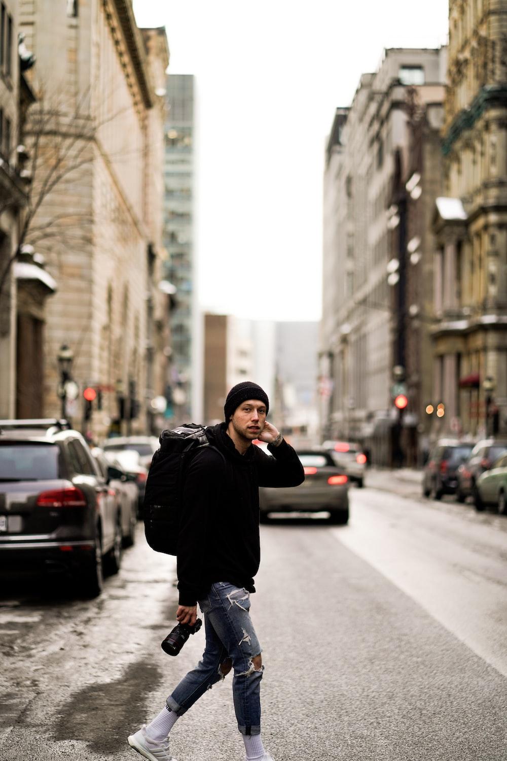 man walking on paved road