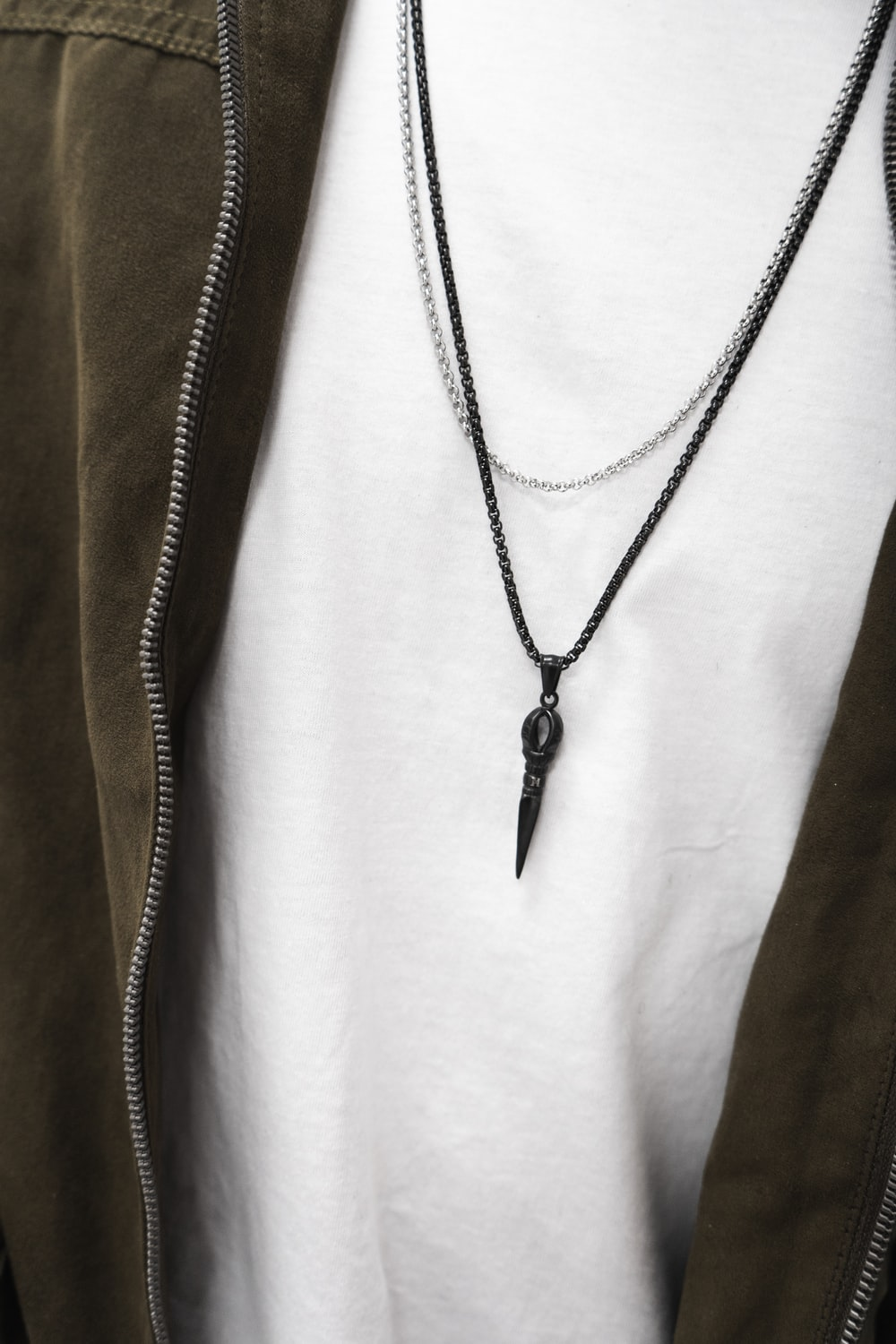 person wearing black necklace