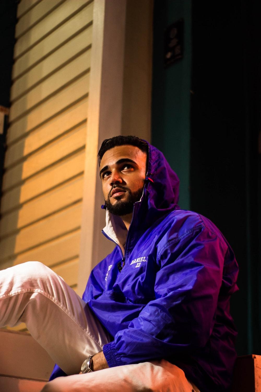 man wearing purple hooded jacket