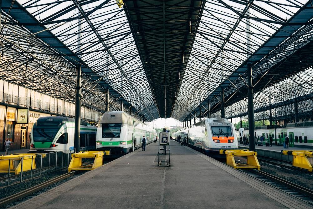 white trains in rail