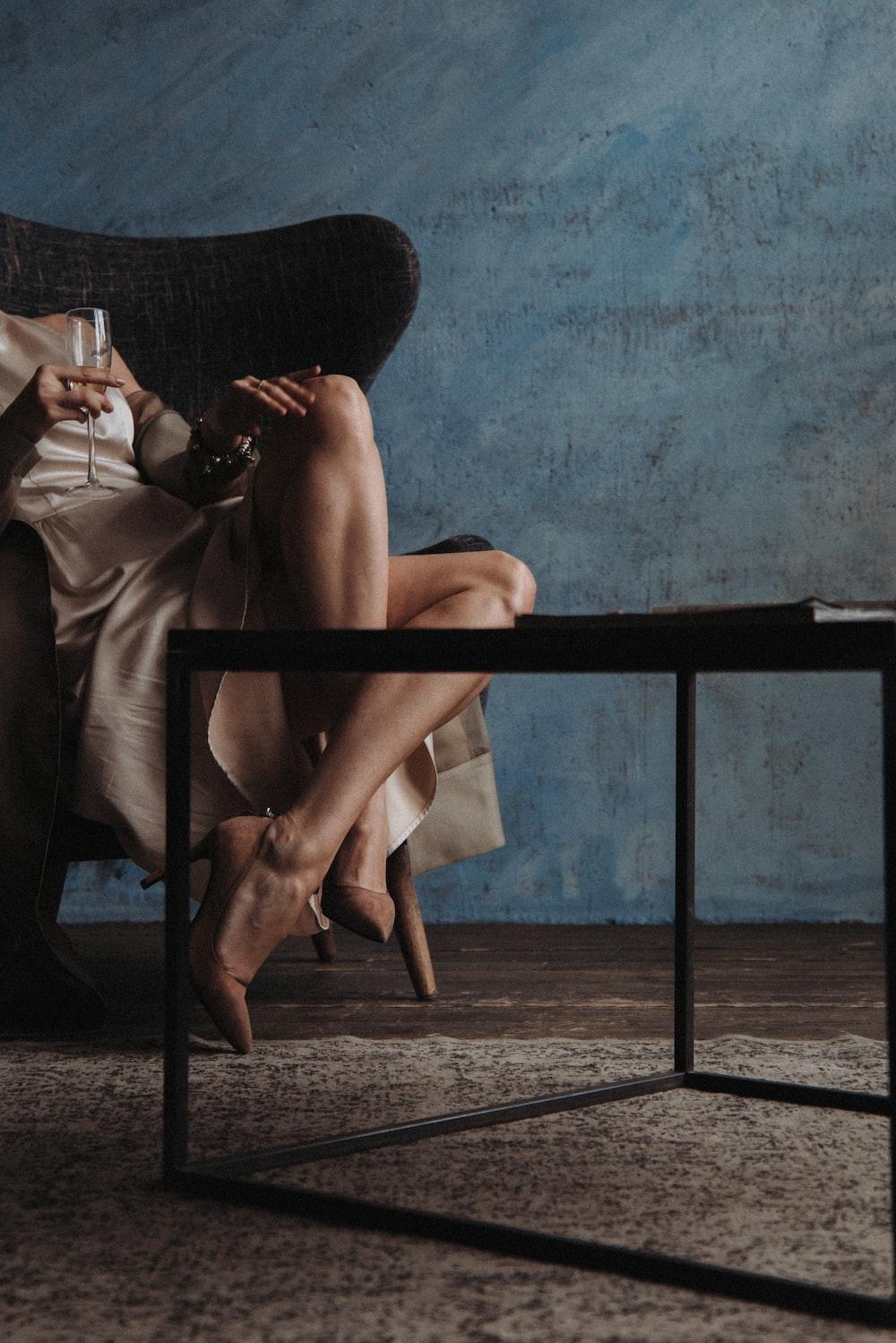 woman sitting on sofa chair