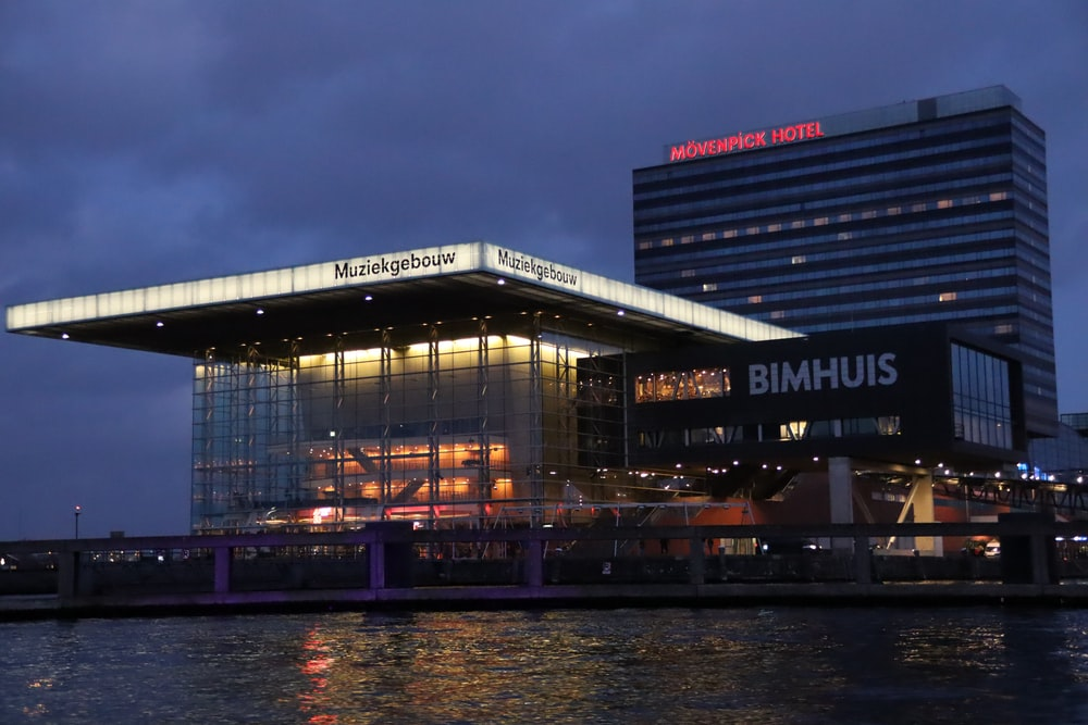 view photography of Bumhuis building near sea