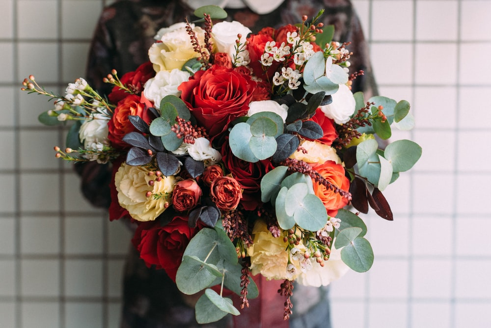 red, white, and green bouquet of flower