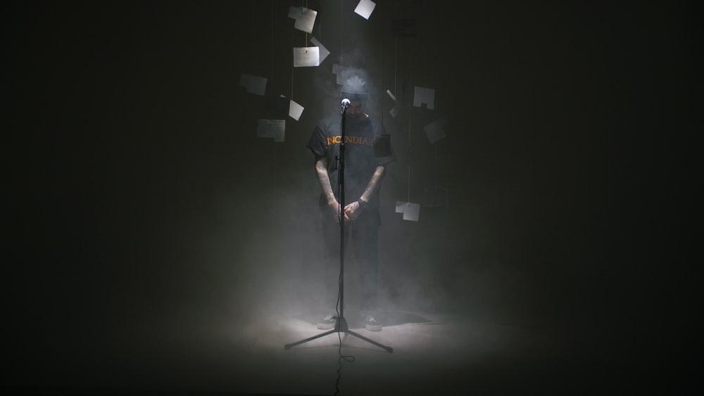 man standing near microphone