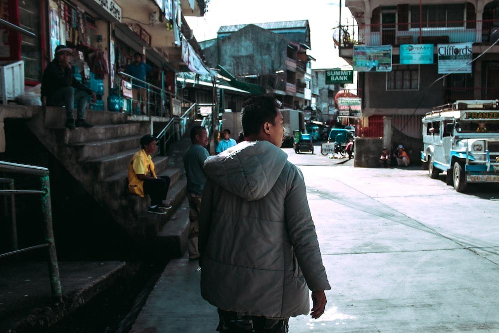 man wearing gray jacket
